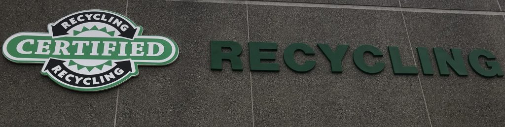 Certified Recycling Logo on side of building